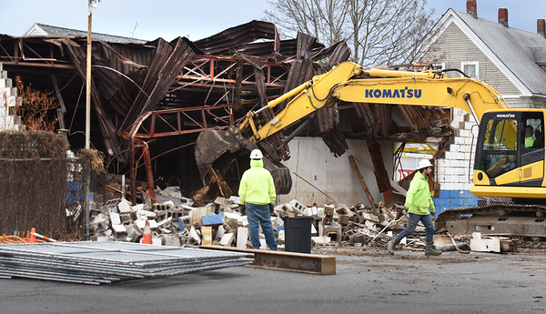 BRYAN EATON/Staff photo. The building that once housed Great Bay Auto at the old Fitzgerald Car lot at the corner of Liberty and Pike Streets in Newburyport was demolished yesterday.