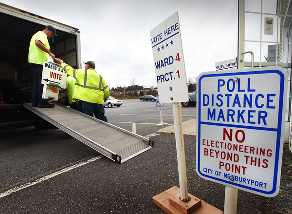 BRYAN EATON/Staff photo. A crew from Newburyport DPS unload signs,  booths and voting machines at the Hope Church where residents from Wards three and four vote in today's election.