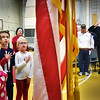 BRYAN EATON/Staff photo. Cashman Elementary School students and local veterans say the Pledge of Allegiance at the beginning of an assembly honoring those who served in the military. The assembly is an annual event for the Amesbury School.