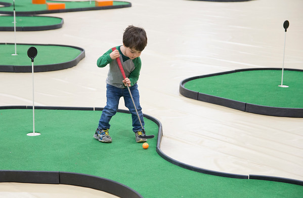JIM VAIKNORAS/Staff photo Mason Lewis, 2, putts Friday night while playing mini-golf at the Newburyport high school gym Friday. The annual event run by the junior class, which also included face painting and a putting contest raised money for the Jimmy Fund.