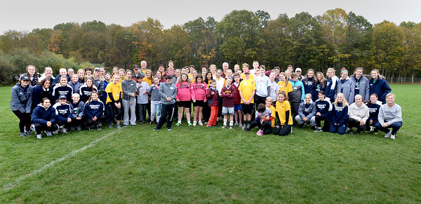 BRYAN EATON/Staff photo. Members of the Junior Clippers Special Olympics Team posed with members of the Endicott College girls soccer team at Cherry Hill Field on Sunday for an end of season scrimmage and celebration.