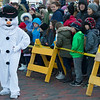 JIM VAIKNORAS/Staff photo Frosty entertains the crowd at the annual Santa Parade and Tree Lighting in Market Square in Newburyport Sunday.