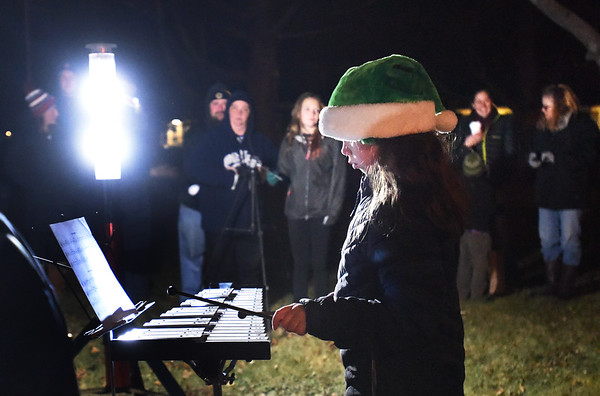 BRYAN EATON/Staff photo. Skylar Colburn, with other members of the Salisbury Elementary School Band, plays the xylophone in Salisbury Square on Sunday night before the lighting of the Christmas Tree. The Salisbury Historical Society's building was open for tours beforehand and for refreshments afterwards, provided by the East Parish United Methodist Church.