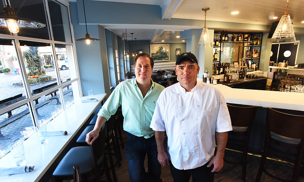 BRYAN EATON/Staff photo. Dave Pierre, left, owner of the new West Row Bar and Grill which opened in Newburyport's Market Square on Tuesday, and Chris McGowan, chef and director of operations.