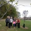 BRYAN EATON/Staff photo. Newburyport Tree Committee put in some new trees behind the Nock Middle School. Gathering for a photograph were tree members and school officials, Colin Klapes, Lexi Klapes, Lisa Furlong, Connie Preston, Susan Viccaro, Tara Rossi, Sue Brown, Angela Bik, Steve Bergholm, Dave Dylewski and Wayne Amaral.