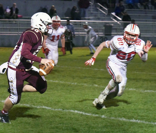 BRYAN EATON/Staff photo. Austin Hallisey moves in to tackle Whittier quarterback Kevin Bradley.