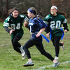 JIM VAIKNORAS/Staff photo Triton's Taylor Penniman turns the corner during the annual Powder Puff football game at Pentucket Saturday. Pentucket defeated the Viking 21-13.