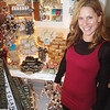 Dave Rogers/Staff photo. Michele Diodati of the Plum Island Soap Co.employes three full-time and one part-time workers at her Northern Boulevard store.