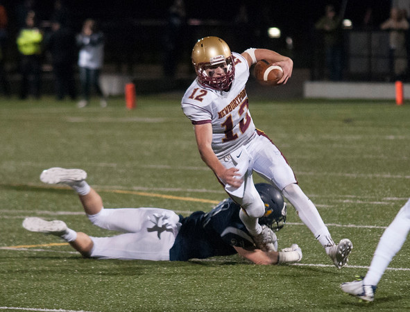 JIM VAIKNORAS/Staff photo Newburyport's Owen Bradbury steps out of a tackle at Lynnfield Friday night.