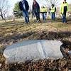 BRYAN EATON/Staff photo. Bob and Lore Switzer of Pepperell approach the gravestone of Lydia Smith who died in 1745 with members of the Newburyport Department of Public Service at the Old Hill Burying Ground. They found the front portion of the stone at their Pepperell home and traced it to Newburyport and returned it to officials. Foreman Alan Frost found the backing of the stone through records, pieced it together and replaced the stone yesterday on the 272nd anniversary of Smith's death.