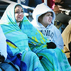 BRYAN EATON/Staff photo. Sisters Hannah Doub, 16, left, and Ashley, 14, bundle up against the legendary cold weather at Triton High School's stadium to watch the Thanksgiving Day game with Pentucket. The two, from Fayetteville, North Carolina, were visiting their aunt Deanna Fecteau's family in Rowley for Thanksgiving.