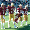 JIM VAIKNORAS/Staff photo Newburyport captain's Myles Maloof, Connor Smith, Owen Bradbury, and Matthew Donlan carry a jersey honoring Thomas Smolski former coach and father of current coach Ben Smolski out for the coin flip at the Start of the Newburyport/Amesbury Thanksgiving football game at World War Memorial Stadium in Newburyport Thursday. Smolski past away this past spring and was a long time member of the Clippers family.