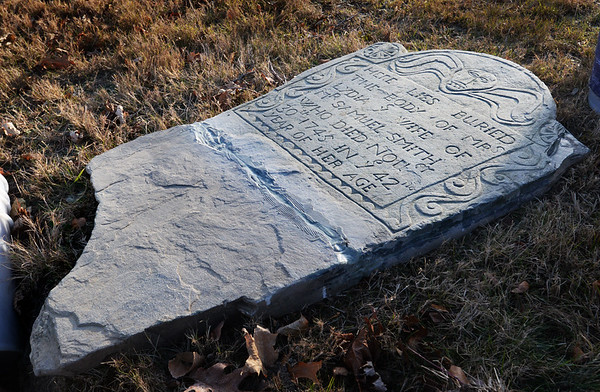BRYAN EATON/Staff photo. The gravestone of Lydia Smith ready to returned to its spot.