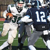BRYAN EATON/Staff photo. Triton's Jack Tummino is ready to stop Pentucket's Jacob Codair.