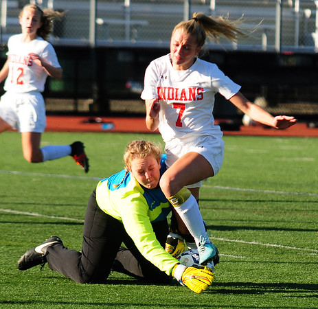 JIM VAIKNORAS/Staff photo Amesbury's  Grace Doherty collides with the St. Joseph's Prep goalie at Manning Field in Lynn Sunday afternoon.