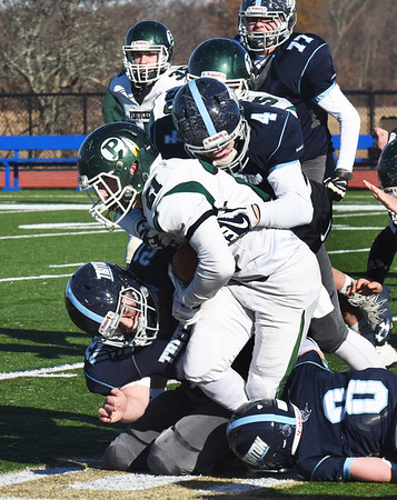 BRYAN EATON/Staff photo. Triton defenders stop Pentucket's Brandon Wilbur.
