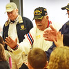 "BRYAN EATON/Staff photo. Amesbury's Cashman School held their annual Veteran's Day assembly with the Pledge of Allegiance, singing of the ""Star Spangled Banner"" and several other patriotic songs. At the end, the nine veterans who attended lined up to recieve ""high-fives"" on their way out, pictured, from left, Kevin Hunt, Bill Burnham and Mark Vedrani."