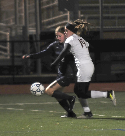 JIM VAIKNORAS/Staff photo Newburyport's Krysta Padellaro defends against Swampscott's Allison Tribendis at Manning Field in Lynn Sunday Night.