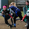 JIM VAIKNORAS/Staff photo Pentucket' sFiona Hill makes a move during the annual Powder Puff football game against Triton at Pentucket Saturday. Pentucket defeated the Viking 21-13.
