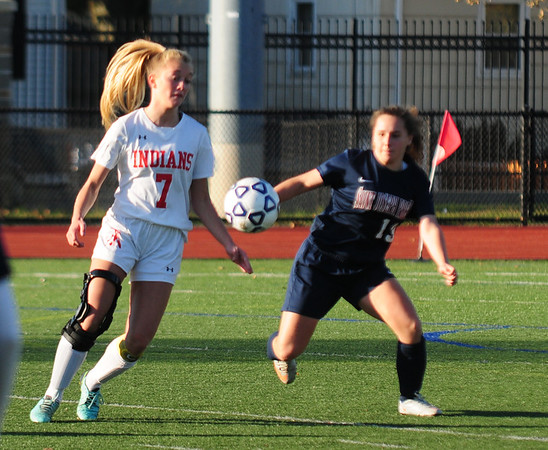 JIM VAIKNORAS/Staff photo Amesbury's  Grace Doherty makes a play on the ball against St. Joseph's Prep at Manning Field in Lynn Sunday afternoon
