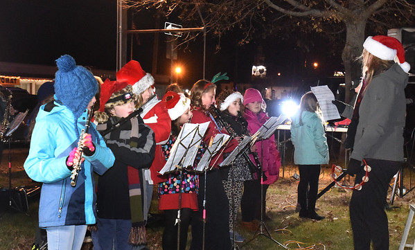 BRYAN EATON/Staff photo. SMembers of the Salisbury Elementary School Band, play seasonal music in Salisbury Square on Sunday night before the lighting of the Christmas Tree. The Salisbury Historical Society's building was open for tours beforehand and for refreshments afterwards, provided by the East Parish United Methodist Church.