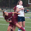 JIM VAIKNORAS/Staff photo  Newburyport's Maria Hgan goes up for a header with  Lynnfield's Katherine Mitchell  Monday. The Clippers defeated Lynnfield in Lynnfield 1-0 in overtime.