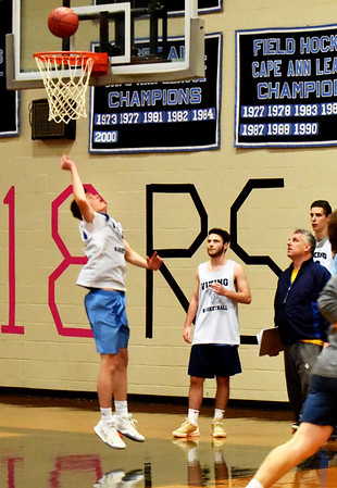 BRYAN EATON/Staff photo. New Triton High boys basketball coach EJ Perry watches the team in tryouts last night.