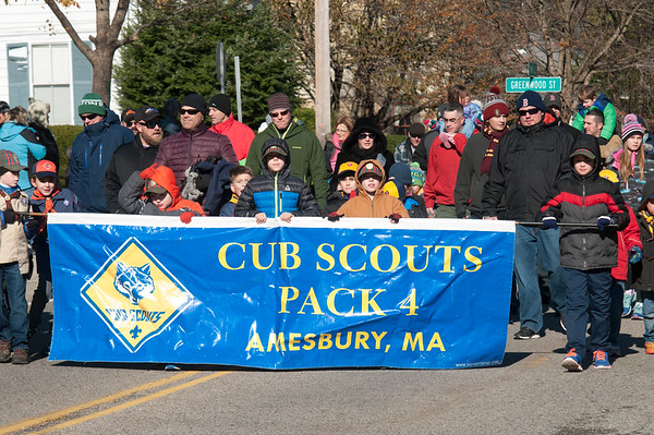 JIM VAIKNORAS/Staff photo Cub Scout Pack 4 march up Main Street in the Veterans Day Parade in Amesbury Saturday.