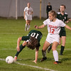 JIM VAIKNORAS/Staff photo Amesbury's Chelsea Lynch and Manchester-Essex player Claire O'Brien fight for the ball during their game at Landry Stadium in Amesbury Friday night.