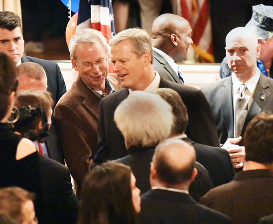 BRYAN EATON/Staff photo. Governor Charlie Baker presses the flesh at the Mission Oak Grill on Wednesday night. He was in town attending a fundraiser for state Rep. Jim Kelcourse.