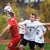 BRYAN EATON/Staff photo. A Melrose player and Keegan O'Keefe go for a loose ball.