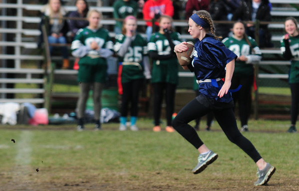 JIM VAIKNORAS/Staff photo Triton's Taylor Penniman scores on a long run during the annual Powder Puff football game at Pentucket Saturday. Pentucket defeated the Viking 21-13.