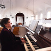 BRYAN EATON/Staff photo. Andrea DeGiovanni, the music director of the Belleville Congregational Church in Newburyport, at the keyboard of their 150 year-old organ. The church is having a fundraiser to renovate the organ and make repairs to the ceiling of the sanctuary.