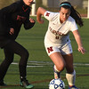 BRYAN EATON/Staff photo. Newburyport's Sami Kelleher gets the ball past a Wayland player.