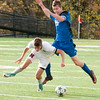 JIM VAIKNORAS/Staff photo Newburyport's William Sidford goes for a loose ball with Bedford's Christopher Cowles at World War Memorial Stadium in Newburyport.
