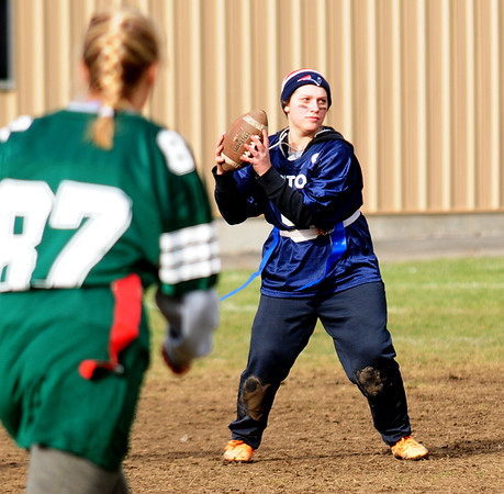 JIM VAIKNORAS/Staff photo Triton's Daniel West gets ready to hand off during the annual Powder Puff football game at Pentucket Saturday. Pentucket defeated the Viking 21-13.