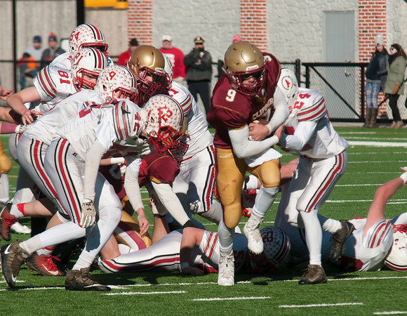 JIM VAIKNORAS/Staff photo Newburyport's Myles Maloof breaks through the line at the Newburyport/Amesbury Thanksgiving football game at World War Memorial Stadium in Newburyport Thursday.