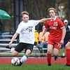 BRYAN EATON/Staff photo. Pentucket's Jack Queenan kicks the ball past a Melrose player.