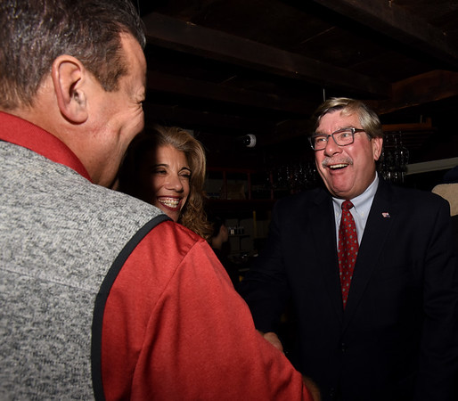 BRYAN EATON/Staff photo. Robert Cronin is congratulated by supporters at his gathering at Andiamo despite coming up short in votes against  Newburyport Mayor Donna Holaday.