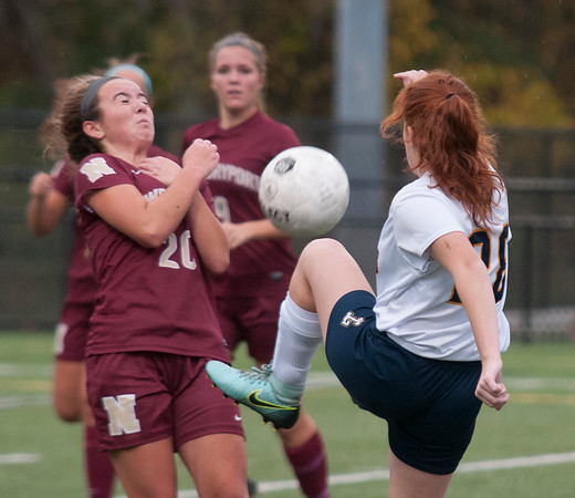 JIM VAIKNORAS/Staff photo  Newburyport'sOlivia Sullivan blocks a shot by  Lynnfield's Hannah Filipe  Monday. The Clippers won the game in Lynnfield 1-0 in overtime.