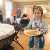 JIM VAIKNORAS/Staff photo Juliana Kane, 10 of West Newbury serves turkey dinner at the Newburyport Lions Club Thanksgiving dinner at the Senior Center in Newburyport Thursday. About 70 volunteer served over 250 dinner at the annual event.