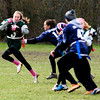 JIM VAIKNORAS/Staff photo Pentucket's Sage Tedesco looks for running room during the annual Powder Puff football game against Triton at Pentucket Saturday. Pentucket defeated the Viking 21-13.