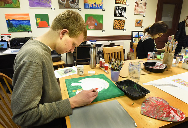 BRYAN EATON/Staff photo. Ben, left, paints a turkey, and Emily paints a landscape.