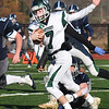 BRYAN EATON/Staff photo. A Triton defender grabs onto Pentucket quarterback Gus Flaherty.