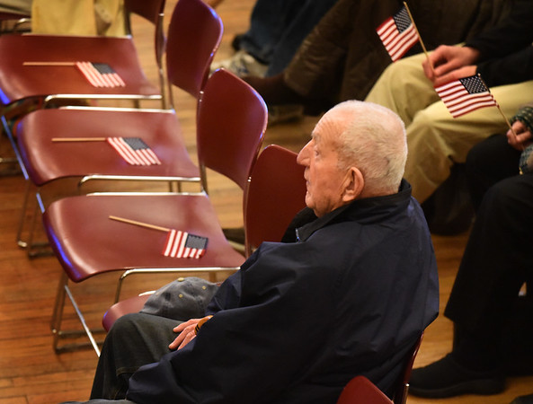 "BRYAN EATON/Staff photo. World War II veteran Robert ""Boots"" Chouinard of Salisbury listens to the Newburyport Veterans' Day services."
