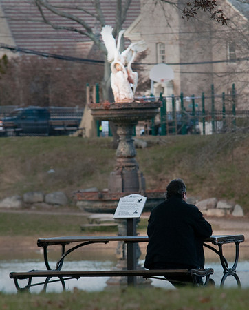 JIM VAIKNORAS/Staff photo A man relaxes on one of the picnic tables at the Bartlet Mall in Newburyport Wednesday morning.