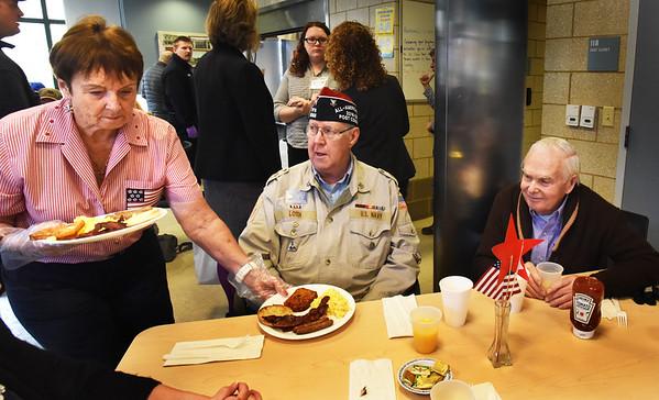 BRYAN EATON/Staff photo. Alma Jewett serves Craig Loth of Byfield and Bob Moreau of Salisbury, both U.S. Navy veterans.