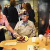 BRYAN EATON/Staff photo. Alma Jewett serves Craig Loth of Byfield and Bob Moreau of Salisbury, both U.S. Navy veterans.