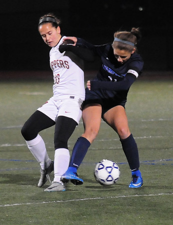 JIM VAIKNORAS/Staff photo Newburyport's Maria Hogan fights for the ball with Swampscott's Emma Fogg at Manning Field in Lynn Sunday Night.
