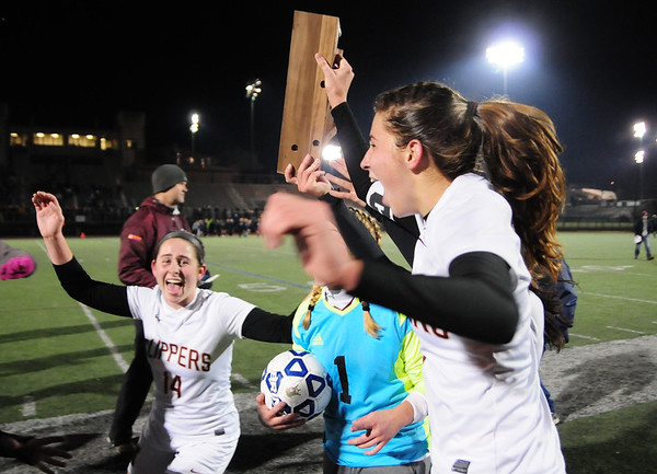 JIM VAIKNORAS/Staff photo The Newburyport girls soccer captains celebrate with their trophy after defeating Swampscott to claim the North Sectional championship at Manning Field in Lynn Sunday Night.